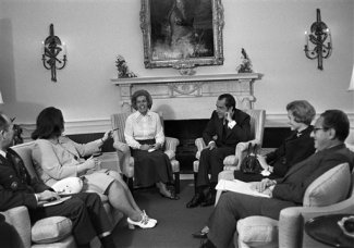 President Richard Nixon meets in his office at the White House in Washington , May 15, 1972, with representatives of the National League of Families of American Prisoners and Missing in Southeast Asia. In attendance are, from left: Gen. Brent Scowcroft, presidential Air Force aide; Maureen A. Dunn of Randolph, Mass.; Sybil E. Stockdale of Coronado, Calif.; Nixon; Phyllis E. Galanti of Richmond, Va.; and Henry Kissinger, assistant to the president. (AP Photo/John Duricka)