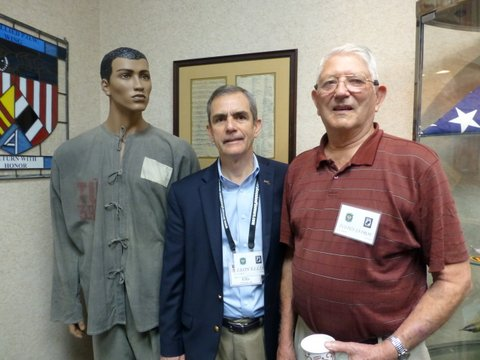Lee with his friend, cell mate, and longtime mentor, Col Jay Jayroe. The black (now faded to gray) pajamas on the mannequin are Lee's prison outfit that he wore for more than five years -- at least on cold days.