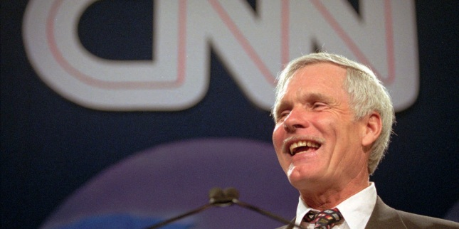 Ted Turner laughs as he speaks during the CNN World Report Contributors banquet in Atlanta, Thursday, May 4, 1995. Turner said he will expand CNN's coverage of medical news. (AP Photo/John Bazemore)